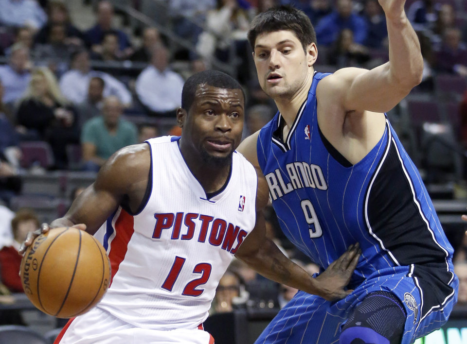 Detroit Pistons guard Will Bynum (12) drives to the basket past Orlando Magic center Nikola Vucevic (9) in the second half of an NBA basketball game Tuesday, Jan. 22, 2013, in Detroit. The Pistons defeated the Magic 105-90. (AP Photo/Duane Burleson)