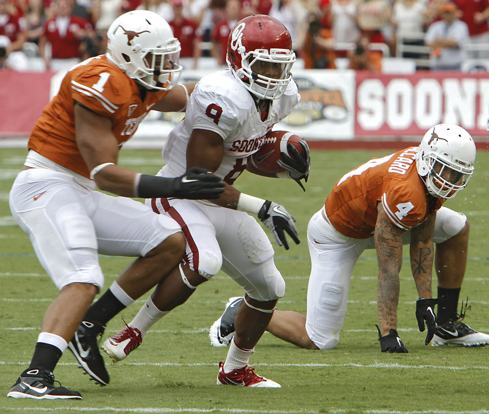 Photo - Texas' Keenan Robinson (1) tries to stop Oklahoma's Dominique Whaley (8) during the Red River Rivalry college football game between the University of Oklahoma Sooners (OU) and the University of Texas Longhorns (UT) at the Cotton Bowl in Dallas, Saturday, Oct. 8, 2011. Photo by Chris Landsberger, The Oklahoman