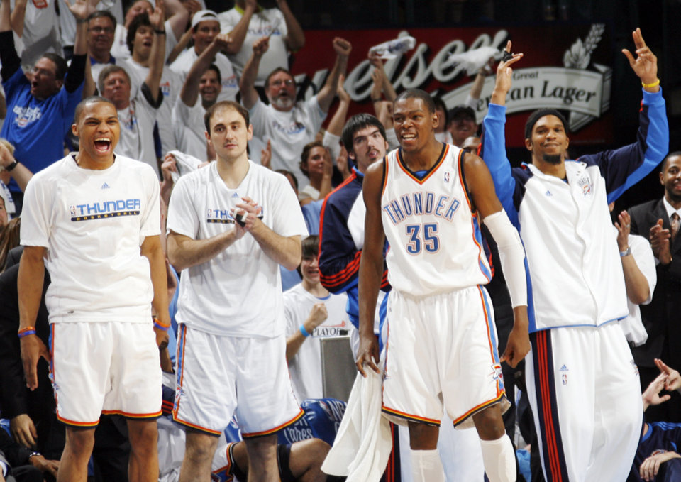 GAME FOUR / L.A. LAKERS / CELEBRATION: From left, Oklahoma City\'s Russell Westbrook, Nenad Krstic, Kevin Durant and Etan Thomas celebrate in the bench area in the fourth quarter during the NBA basketball game between the Los Angeles Lakers and the Oklahoma City Thunder in the first round of the NBA playoffs at the Ford Center in Oklahoma City, Saturday, April 24, 2010. Oklahoma City won, 110-89. Photo by Nate Billings, The Oklahoman ORG XMIT: KOD