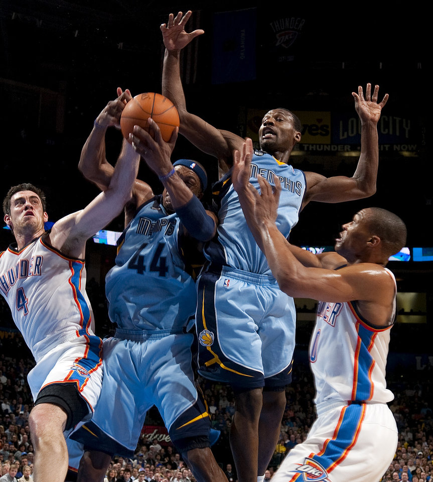 Oklahoma City's Nick Collison (4) and Russell Westbrook (0) go for a rebound along with Memphis' Dante Cunningham (44) and Tony Allen (9) during the NBA game between the Oklahoma City Thunder and the Memphis Grizzlies at Chesapeake Energy Arena in Oklahoma CIty, Friday, Feb. 3, 2012. Photo by Bryan Terry, The Oklahoman