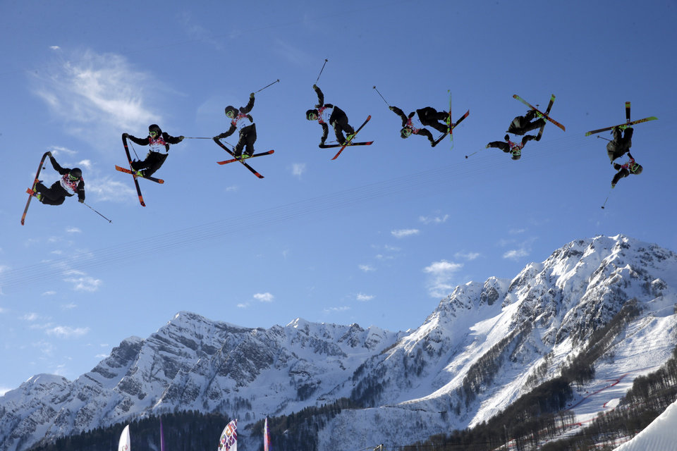 Photo - In this image made with a multiple exposure, Finland's Antti Ollila competes in the men's ski slopestyle qualifying at the Rosa Khutor Extreme Park during the 2014 Winter Olympics, Thursday, Feb. 13, 2014, in Krasnaya Polyana, Russia. (AP Photo/Gero Breloer)