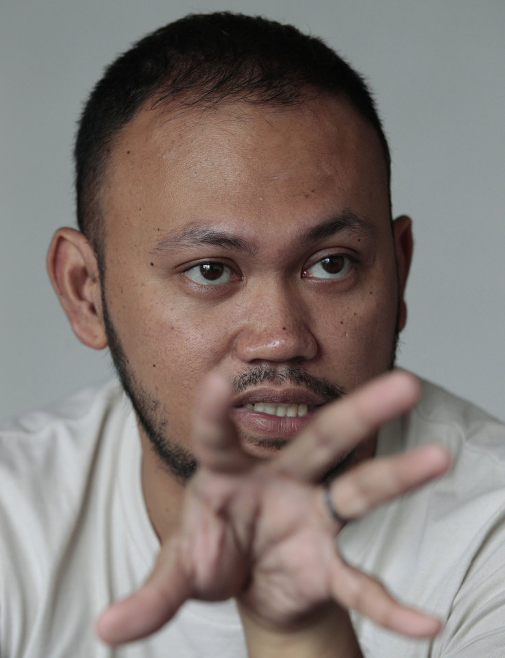In this photo taken on May 8, 2013, Filipino director Borinaga Alix Jr. gestures during an interview inside his home in suburban Quezon city, north of Manila, Philippines. Alix could have shot his film