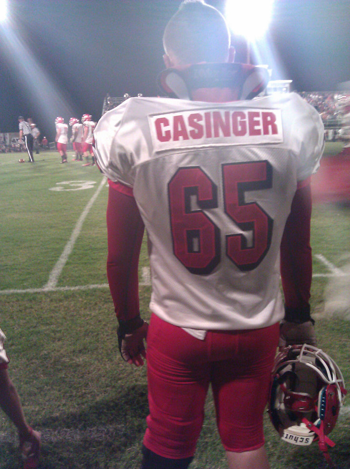 Photo - Stigler's Austan Drewry was chosen to wear Cory Casinger's No. 65 for the game against Eufaula on Friday, Sept. 28. PHOTO BY RYAN ABER, THE OKLAHOMAN