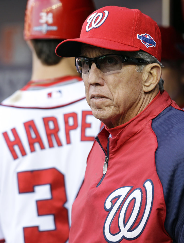 Washington Nationals manager Davey Johnson looks on from the dugout in the ninth inning of Game 3 of the National League division baseball series against the St. Louis Cardinals on Wednesday, Oct. 10, 2012, in Washington. St. Louis won 8-0. (AP Photo/Alex Brandon)