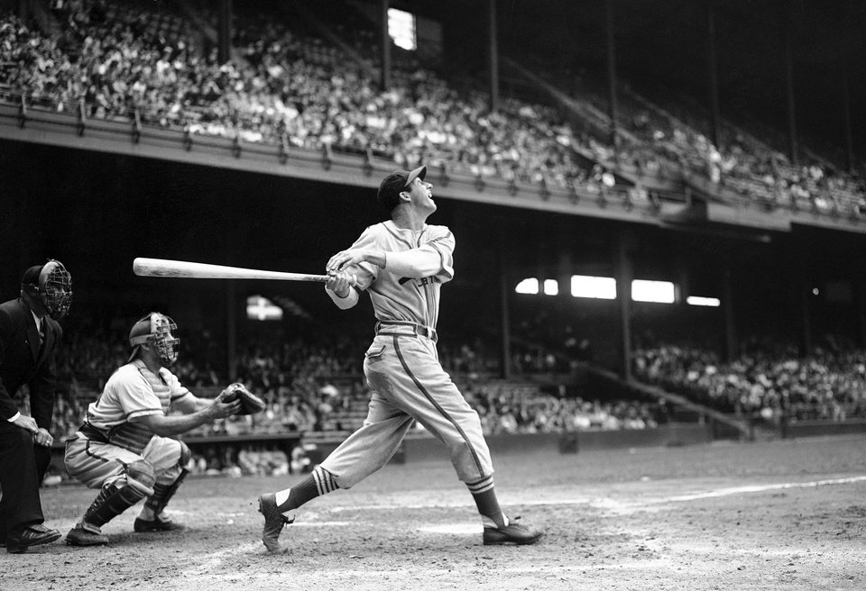 In this May 22, 1946 file photo, St. Louis Cardinals' Stan Musial bats against the Philadelphia Phillies during a baseball game at Shibe Park in Philadelphia, Pa. Musial, one of baseball's greatest hitters and a Hall of Famer with the Cardinals for more than two decades, died Saturday, Jan 19, 2013, the team announced. He was 92. (AP Photo/Warren M. Winterbottom, File)