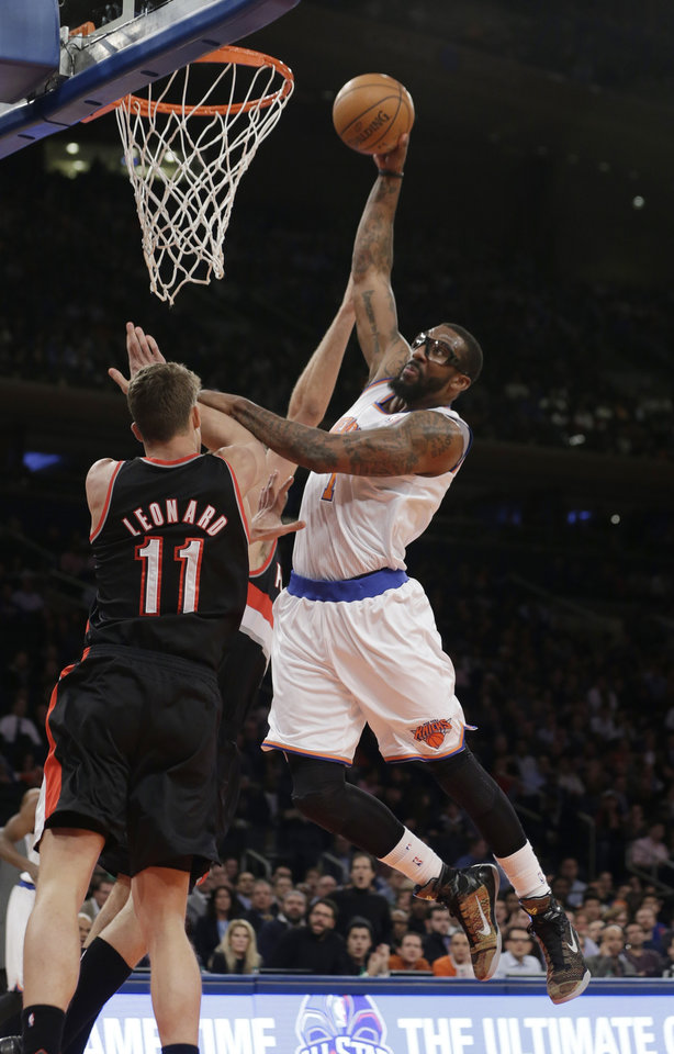 Photo - New York Knicks' Amar'e Stoudemire (1) dunks the ball on Portland Trail Blazers' Meyers Leonard (11) during the first half of an NBA basketball game, Wednesday, Feb. 5, 2014, in New York. (AP Photo/Frank Franklin II)