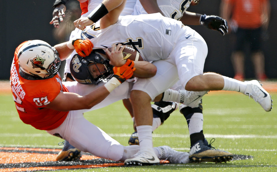 Photo - Oklahoma State's Cole Walterscheid (82) sacks Pittsburgh's Nathan Peterman (4) during a college football game between the Oklahoma State Cowboys (OSU) and the Pitt Panthers at Boone Pickens Stadium in Stillwater, Okla., Saturday, Sept. 17, 2016. Photo by Chris Landsberger, The Oklahoman