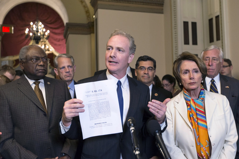 Photo - Rep. Chris Van Hollen, D-Md., center, with House Minority Leader Nancy Pelosi, D-Calif., right, urge House Republicans to return to negotiations to fund the government, during a news conference just before midnight at the Capitol in Washington, Monday, Sept. 30, 2013. For the first time in nearly two decades, the federal government staggered into a partial shutdown Monday at midnight after congressional Republicans stubbornly demanded changes in the nation's health care law as the price for essential federal funding and President Barack Obama and Democrats adamantly refused. Joining Van Hollen and Pelosi are, from left, Assistant Minority Leader James Clyburn, D-S.C., Rep. Steve Israel, D-N.Y., Rep. Xavier Becerra, D-Calif., and House Minority Whip Steny Hoyer, D-Md. (AP Photo/J. Scott Applewhite)