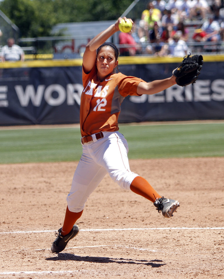 Photo - Texas pitcher Blaire Luna pitches in the Women's College World Series elimination game versus Florida. The Longhorns would go on to win 3-0 as Luna allowed only one hit in seven innings pitched. Photo by KT KING, The Oklahoman