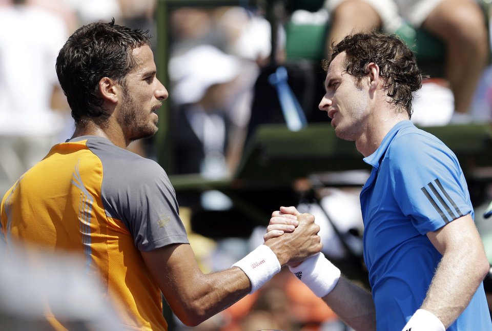 Photo - Feliciano Lopez, left, of Spain, greets Andy Murray, of Great Britain, after Murray's 6-4, 6-1 win at the Sony Open tennis tournament in Key Biscayne, Fla., Sunday, March 23, 2014. (AP Photo/Alan Diaz)
