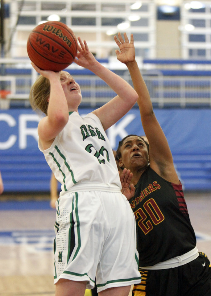 Photo - Bishop McGuinness' Aspen Weber makes a shot over PC North's Malachi Williams during the Bishop McGuinness vs. PC North girls game of the Deer Creek, Bruce Gray Invitational basketball game at Deer Creek High School in Oklahoma City, OK, Thursday, January 23, 2014,  Photo by Paul Hellstern, The Oklahoman