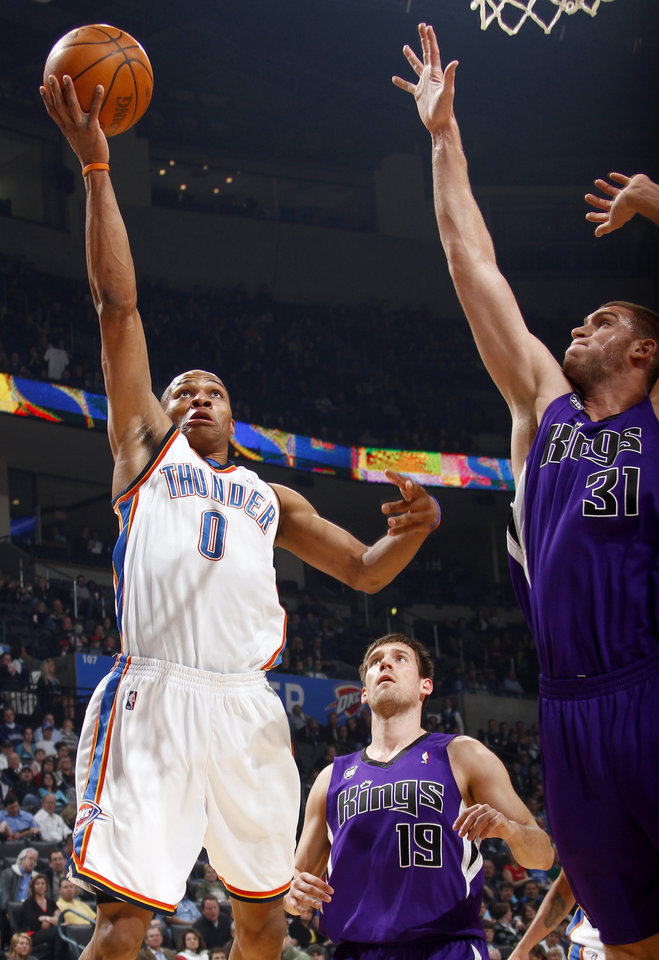 Photo - Oklahoma City's Russell Westbrook goes past Sacramento's Beno Udrih, center, and Spencer Hawes during the NBA basketball game between the Oklahoma City Thunder and the Sacramento Kings at the Ford Center in Oklahoma City, Tuesday, March 2, 2010.  Photo by Bryan Terry, The Oklahoman