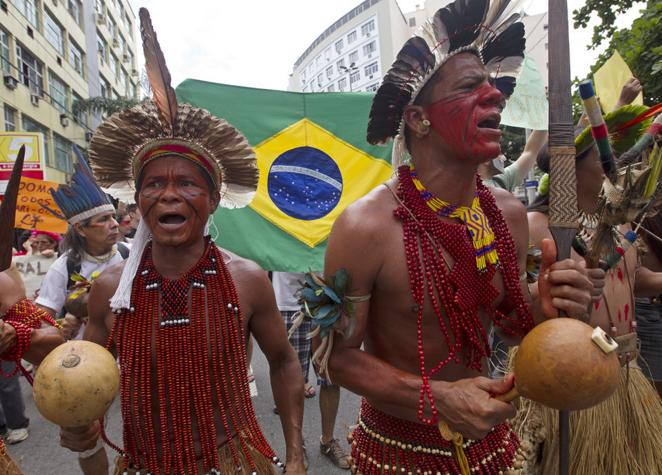 Photo - Brazilians protest against the privatization of the Maracana stadium, in Rio de Janeiro, Brazil, Saturday, Dec. 1, 2012. About 500 people, including Indians and students, protested Saturday, against privatization of the stadium because it will lead to the demolition of a nearby museum and a public school. (AP Photo/Silvia Izquierdo)