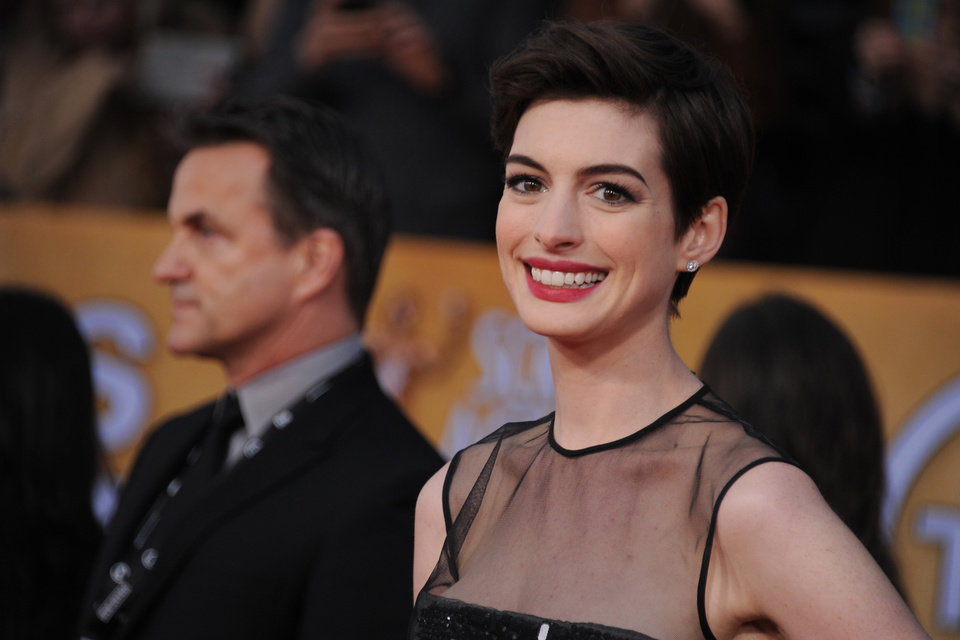 Photo - Actress Anne Hathaway arrives at the 19th Annual Screen Actors Guild Awards at the Shrine Auditorium in Los Angeles on Sunday Jan. 27, 2013. (Photo by Jordan Strauss/Invision/AP)