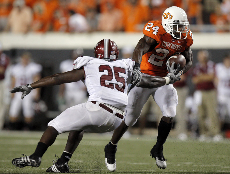 Photo - during the college football game between the Oklahoma State University Cowboys (OSU) and the Troy University Trojans at Boone Pickens Stadium in Stillwater, Okla., Saturday, Sept. 11, 2010. Photo by Sarah Phipps, The Oklahoman