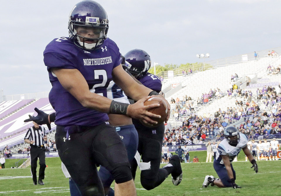 FILE - In this Sept. 21, 2013 file photo, Northwestern quarterback Kain Colter (2), wears APU for