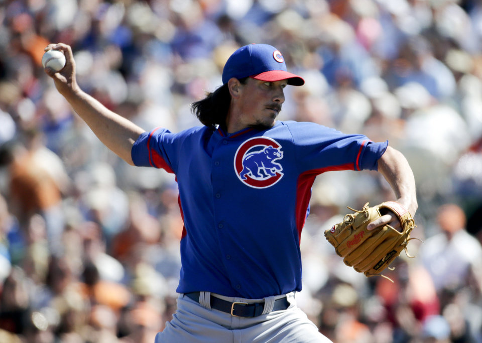 Photo - Chicago Cubs starting pitcher Jeff Samardzija throws to the San Francisco Giants during the first inning of a spring exhibition baseball game in Scottsdale, Ariz., Monday, March 10, 2014. (AP Photo/Chris Carlson)