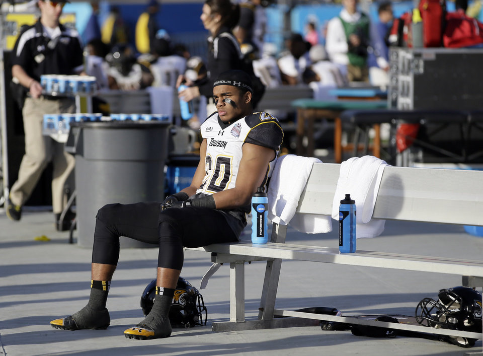 Photo - Towson wide receiver DeAngelo Stephenson (20) sits on the bench late in the second half of the FCS championship NCAA college football game against North Dakota State, Saturday, Jan. 4, 2014, in Frisco, Texas. NDSU won 35-7. (AP Photo/Tony Gutierrez)