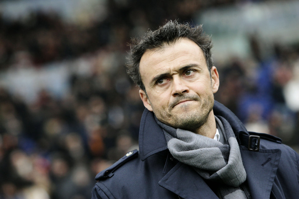 Photo - FILE - In this Sunday, Feb. 19, 2012, file photo, AS Roma coach Luis Enrique, of Spain, waits for the start of a Series A soccer match between AS Roma and Parma, at Rome's Olympic stadium. Barcelona has hired Luis Enrique as its new coach, succeeding Gerardo Martino who stepped down on Saturday after the club failed to defend its Spanish league title. Barcelona said on its website Monday, May 19, 2014, that Enrique has agreed to a two-year deal. (AP Photo/Riccardo De Luca, File)