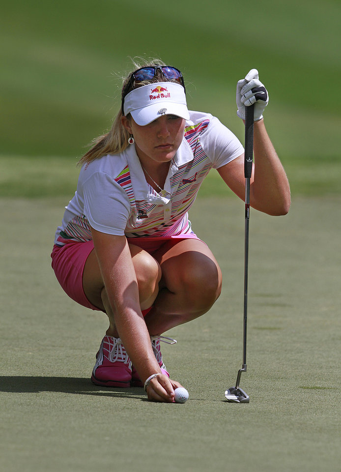Photo -   Lexi Thompson sets her ball on ninth green during the third round of the Mobile Bay LPGA Classic golf tournament, Saturday, April 28, 2012, in Mobile, Ala. (AP Photo/Press-Register, Bill Starling) MAGS OUT
