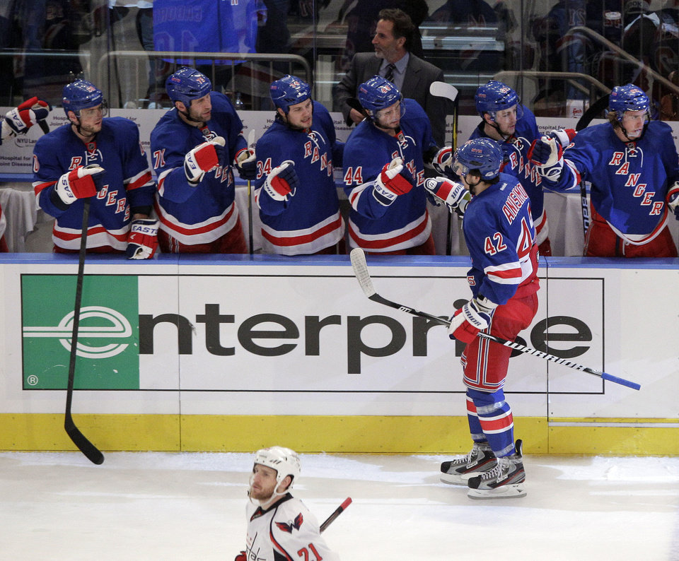 Photo -   New York Rangers' Artem Anisimov (42) celebrates with teammates after scoring during the second period of Game 1 in the second round of the NHL hockey Stanley Cup playoffs against the Washington Capitals Saturday, April 28, 2012, in New York. (AP Photo/Frank Franklin II)