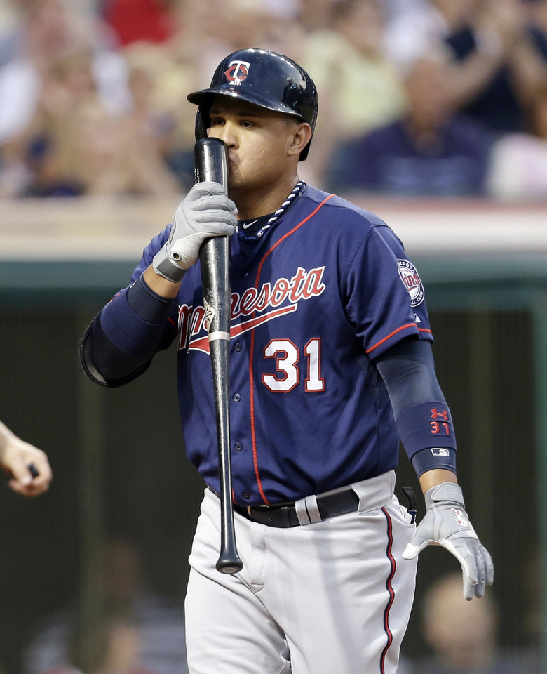 Minnesota Twins\' Oswaldo Arcia kisses his bat after striking out against Cleveland Indians starting pitcher Scott Kazmir in the seventh inning of a baseball game, Friday, June 21, 2013, in Cleveland. (AP Photo/Tony Dejak)