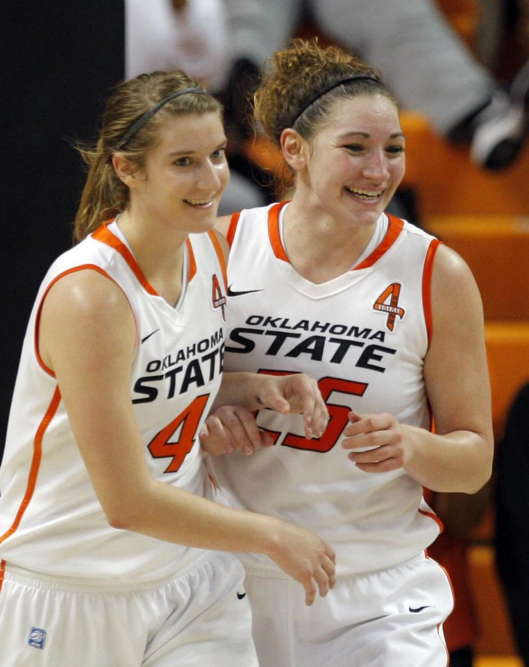 Photo - Oklahoma State's Liz Donohoe (4) and Lindsey Keller (25) celebrate a score during the women's college game between Oklahoma State University and Coppin State at Gallagher-Iba Arena in Stillwater, Okla.,  Saturday, Nov. 26, 2011.  Photo by Sarah Phipps, The Oklahoman