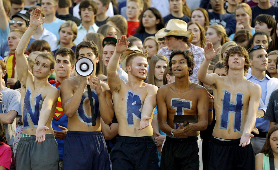 Photo - Edmond North students cheer during a high school football game against Putnam City North at Wantland Stadium in Edmond, Okla., Friday, September 21, 2012. Photo by Bryan Terry, The Oklahoman