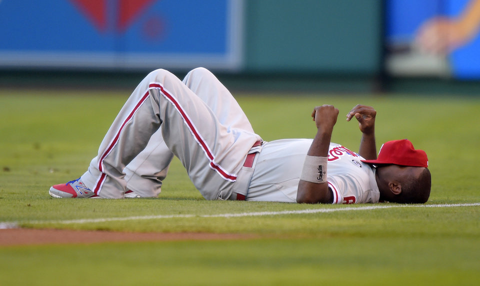 Photo - Philadelphia Phillies' Ryan Howard lays on the field prior to their baseball game against the Los Angeles Angels, Wednesday, Aug. 13, 2014, in Anaheim, Calif. (AP Photo/Mark J. Terrill)
