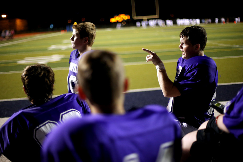 Photo - Colton James talks during halftime of the Sequoyah Middle School football game, Thursday, September 27, 2012. Colton along with teammates Lucas Coker, and Parker Tumleson, helped Keegan Erbst, who has muscular dystrophy and is confined to a wheelchair, get involved with the team. Photo by Bryan Terry, The Oklahoman