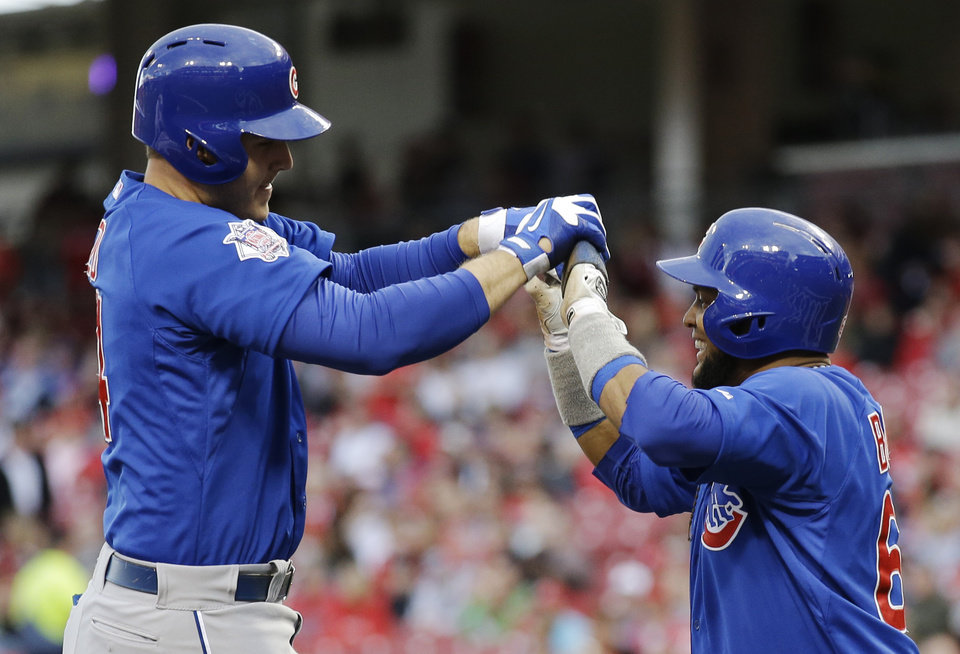Photo - Chicago Cubs' Anthony Rizzo, left, is congratulated by Emilio Bonifacio after  hitting a two-run home run off Cincinnati Reds starting pitcher Tony Cingrani in the first inning of a baseball game on Wednesday, April 30, 2014, in Cincinnati. (AP Photo)