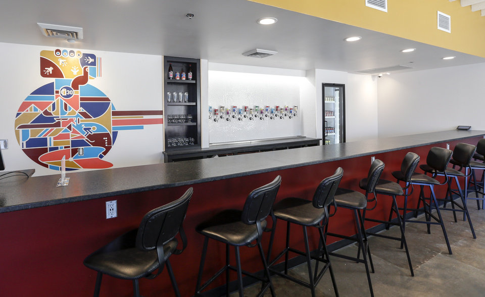 Photo -  The taproom of Elk Valley Brewing includes murals by artist Matt Goad. [Photo by Nate Billings, The Oklahoman]