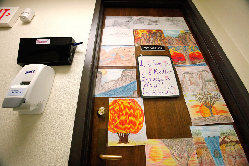 Photo - ABSENTEE SHAWNEE COUNSELING SERVICES / METHADONE CLINIC / ART: Clients' artwork covers the office door of a counselor inside a  clinic where patients addicted to heroin and other opiods are treated in a building operated by the Absentee Shawnee Tribe on SE 59 in Oklahoma City on Thursday, Nov. 10, 2011.   Photo by Jim Beckel, The Oklahoman  ORG XMIT: KOD