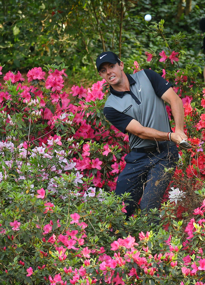 Photo - Rory McIlroy, of Northern Ireland, hits from the azaleas on No. 13 during the second round of the Masters golf tournament, Friday, April 11, 2014, in Augusta, Ga. (AP Photo/Atlanta Journal Constitution, Curtis Compton) MARIETTA DAILY OUT; GWINNETT DAILY POST OUT; WXIA OUT; WGCL OUT; FOX 5 OUT