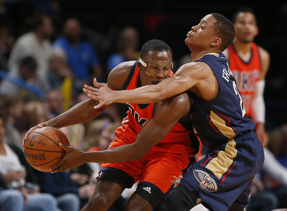 Photo - Oklahoma City's Semaj Christon (6) tries to get by New Orleans' Tim Frazier (2) during the NBA game between the Oklahoma City Thunder and the New Orleans Pelicans at the Chesapeake Energy Arena,  Sunday, Dec. 4, 2016. Photo by Sarah Phipps, The Oklahoman