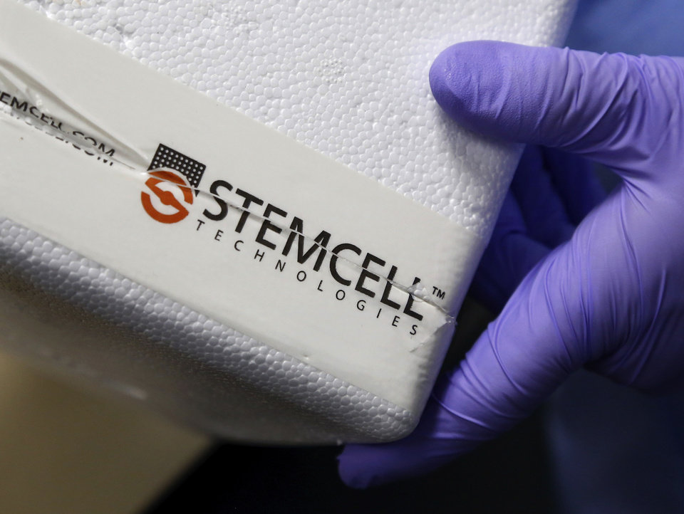 Photo - A lab technician holds a styrofoam container used to transport blood samples into the cryo storage room. container Oklahoma Blood Institute hosted the grand opening of its new Cord Blood Bank Tuesday afternoon, Jan. 28, 2014. It is one of only 24 such centers worldwide. Umbilical cord blood that potentially can save lives has been thrown away after the births of babies across our state in the past. . Without a local public umbilical cord blood bank, most Oklahoma mothers have no option to donate it. Now, families at OU Medical Center, celebrating a joyous event in their own lives can bring the same to those battling leukemia and other blood disorders with little hope. Other hospitals will be enlisted to partner in the future.     Photo by Jim Beckel, The Oklahoman