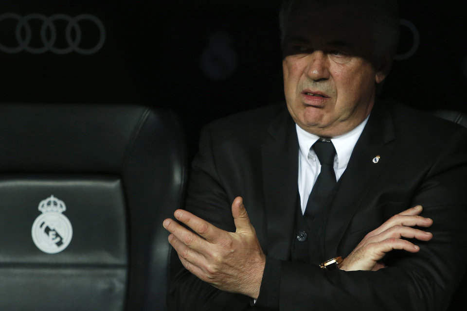 Photo - Real Madrid's coach Carlo Ancelotti gestures during a Spanish La Liga soccer match between Real Madrid and Almeria at the Santiago Bernabeu stadium in Madrid, Spain, Saturday, April 12, 2014. (AP Photo/Andres Kudacki)
