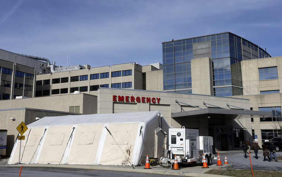 A tent is set up for a patients with flu symptoms, just outside the emergency entrance at the Lehigh Valley Hospital Thursday, Jan. 10, 2013, in Allentown, Pa. The Pennsylvania Department of Health designated flu as now