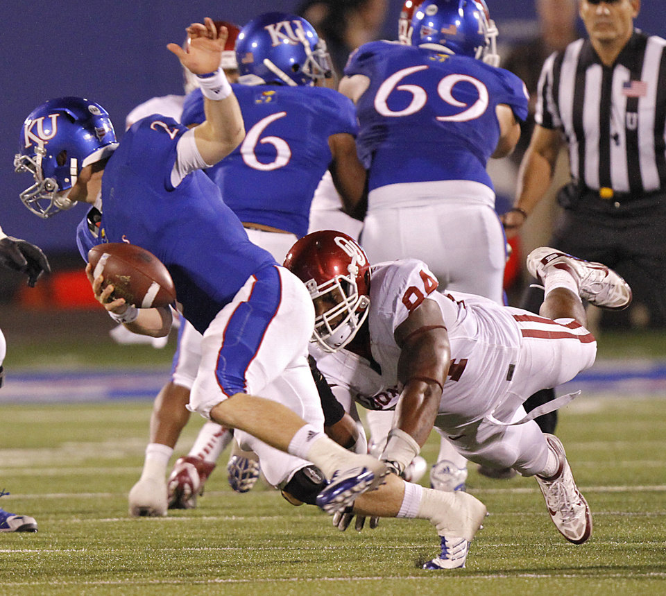 Oklahoma's Frank Alexander (84) dives for Kansas quarterback Jordan Webb (2) during the college football game between the University of Oklahoma Sooners (OU) and the University of Kansas Jayhawks (KU) on Saturday, Oct. 15, 2011. in Lawrence, Kan. Photo by Chris Landsberger, The Oklahoman