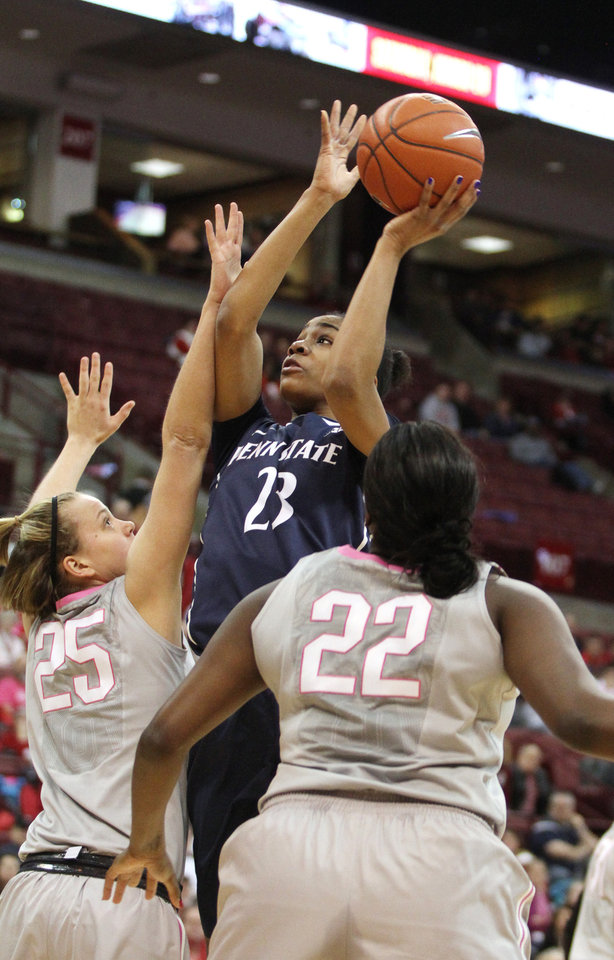 Photo - Penn State's Ariel Edwards (23) shoots over Ohio State's Amy Scullion (25) and Darryce Moore (22) during the first half of an NCAA college basketball game on Sunday, Feb. 9, 2014, in Columbus, Ohio. (AP Photo/Mike Munden)