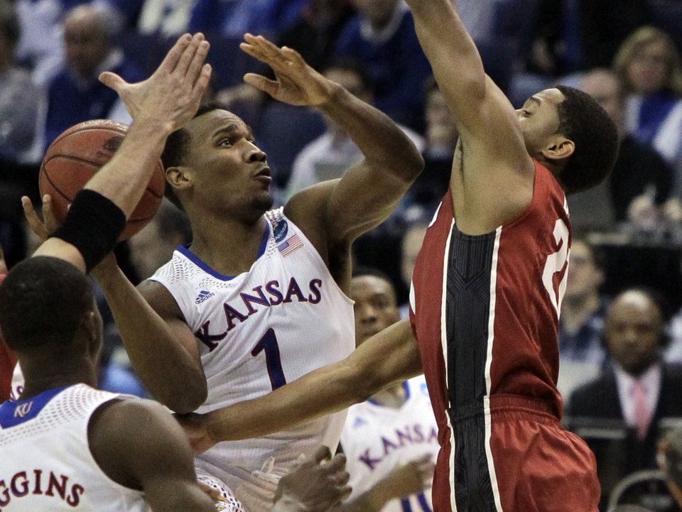 Photo - Kansas' Wayne Selden, Jr., left, shoots as Stanford's Anthony Brown defends during the first half of a third-round game of the NCAA college basketball tournament Sunday, March 23, 2014, in St. Louis. (AP Photo/Jeff Roberson)