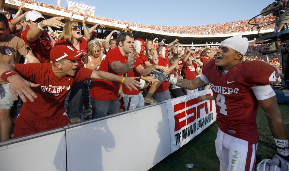OU's Kenny Stills celebrates with fans after  the Red River Rivalry college football game between the University of Oklahoma Sooners (OU) and the University of Texas Longhorns (UT) at the Cotton Bowl on Saturday, Oct. 2, 2010, in Dallas, Texas.  OU defeated Texas 28-20.  Photo by Bryan Terry, The Oklahoman