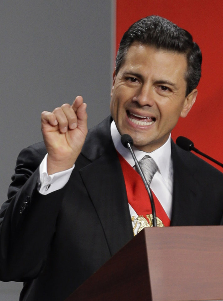 Photo - Mexico's newly sworn-in President Enrique Pena Nieto delivers his inaugural speech at the National Palace in Mexico City, Saturday, Dec. 1, 2012. Protesters opposed to the new president clashed with tear gas-wielding police early Saturday morning outside the National Congress, where Pena Nieto took the oath of office. (AP Photo/Andres Leighton)