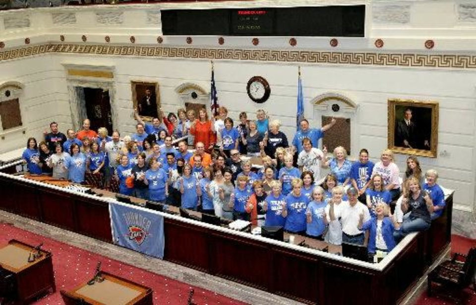 Photo - THUNDER UP! Oklahoma State Senate Staff shows their support for the Oklahoma City Thunder heading into game one of the NBA finals Tuesday, June 12, 2012. Provided