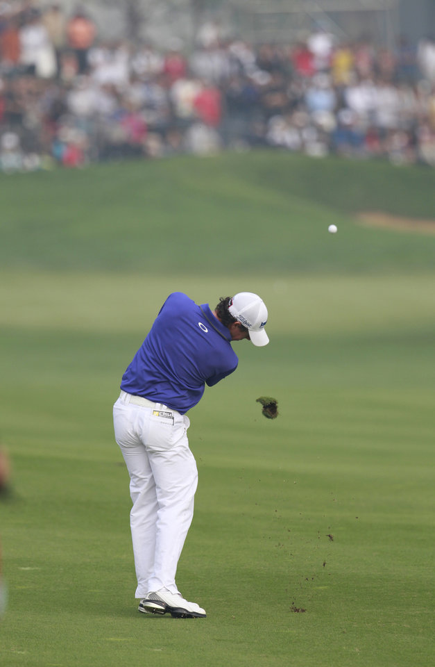 Photo -   Rory McIlroy of Northern Ireland hits a shot from the 9th fairway during the final round of the Masters golf tournament in Shanghai, China on Sunday Oct. 28, 2012. (AP Photo/Eugene Hoshiko)