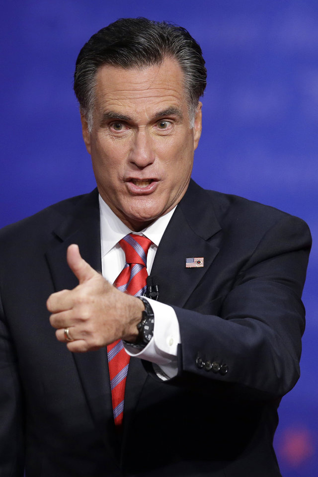 Photo -   Republican presidential nominee Mitt Romney flashes a thumbs up to the audience after the third presidential debate at Lynn University, Monday, Oct. 22, 2012, in Boca Raton, Fla. (AP Photo/Charlie Neibergall)