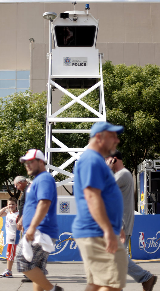 Photo - Fans walk past an Oklahoma City police tower outside the arena Game 2 of the NBA Finals between the Oklahoma City Thunder and the Miami Heat at Chesapeake Energy Arena in Oklahoma City, Thursday, June 14, 2012. Photo by Bryan Terry, The Oklahoman