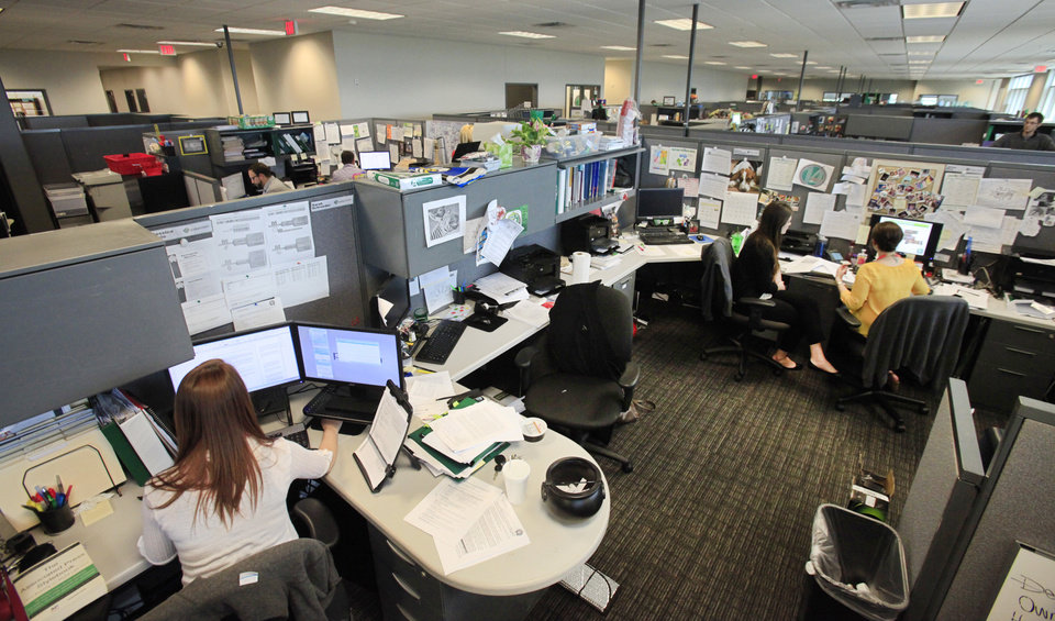 Photo -  Paycom employees work inside the company's northwest Oklahoma City headquarters, which has added about 500 employees since 2011.    David McDaniel -  The Oklahoman