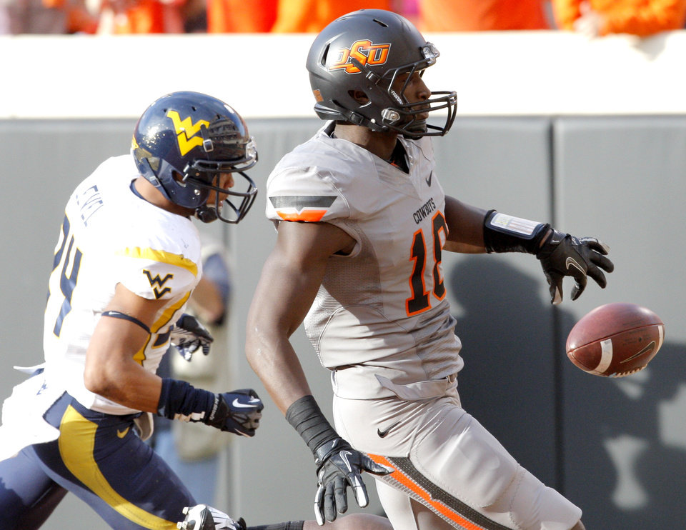 Photo - Oklahoma State's Blake Jackson (18) scores a touchdown in front of Oklahoma State's Miketavius Jones (24) in the second quarter during a college football game between Oklahoma State University (OSU) and the West Virginia University at Boone Pickens Stadium in Stillwater, Okla., Saturday, Nov. 10, 2012. Photo by Sarah Phipps, The Oklahoman