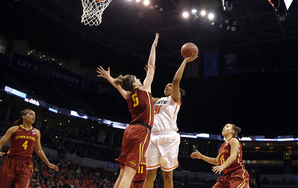 Photo - Oklahoma State's Kendra Suttles (31) shoots over Iowa State's Hallie Christofferson (5) during the Women's Big 12 basketball tournament at  Chesapeake Energy Arena  in Oklahoma City, Okla., Saturday, March 8, 2014. Photo by Sarah Phipps, The Oklahoman